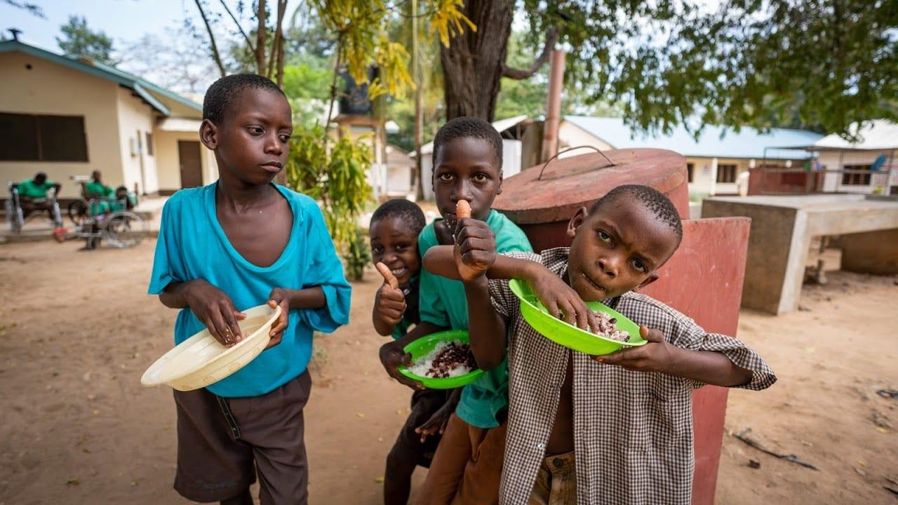 Four Kenyan boys enjoying a snack.