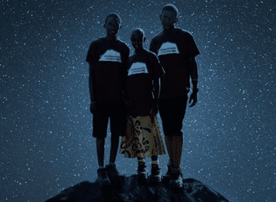 Kupenda Documentary cover- 3 Kenyan teens standing on rocky ground, surrounded by starry sky.
