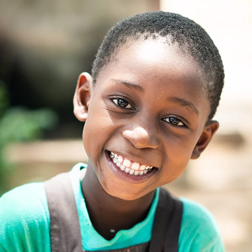 A young boy wearing a green shirt.